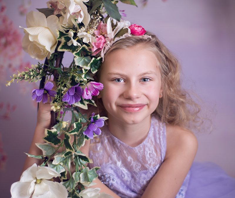 Essex child photographer -Flower swing – beautiful indoor themed pretty photo sessions for children aged 4 and older. Sudbury, Suffolk, photographer offering fine art child portraits on the Suffolk Essex border.