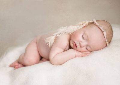 6-month-old-newborn-style-photos---premature-twin-girls-laying-with-a-dreamcatcher-headband---Colchester-Essex-baby-photographer