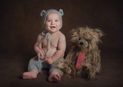 6-month-old-sitting-in-a-bear-hat-with-a-teddy-bear---Essex-child-photographer