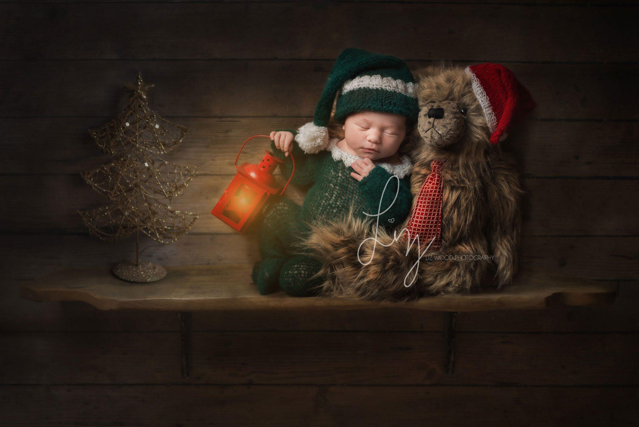 Baby on a shelf dressed as an Elf.
