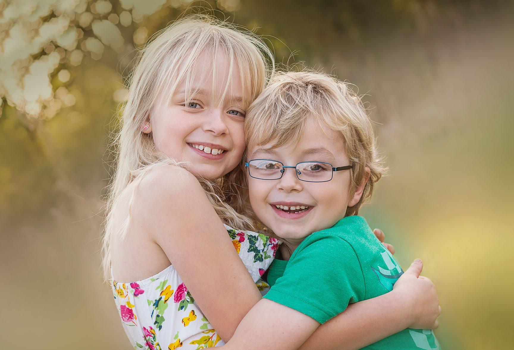 Boy and girl outside photoshoot golden light