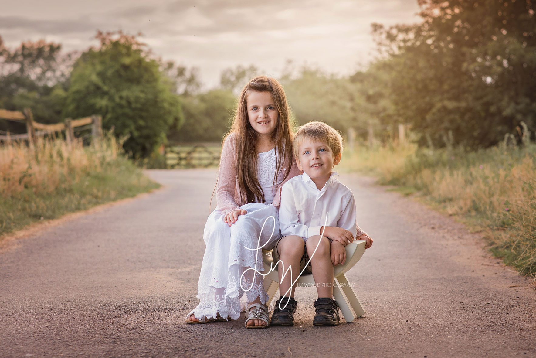 Brother Sister Sitting In Golden Light Essex Photographer Suffolk