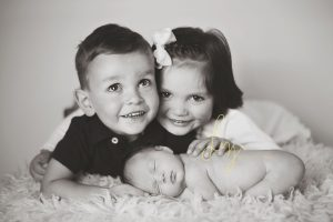 Halstead Essex Newborn Photographer - beautiful sibling shot of a new family cuddled up