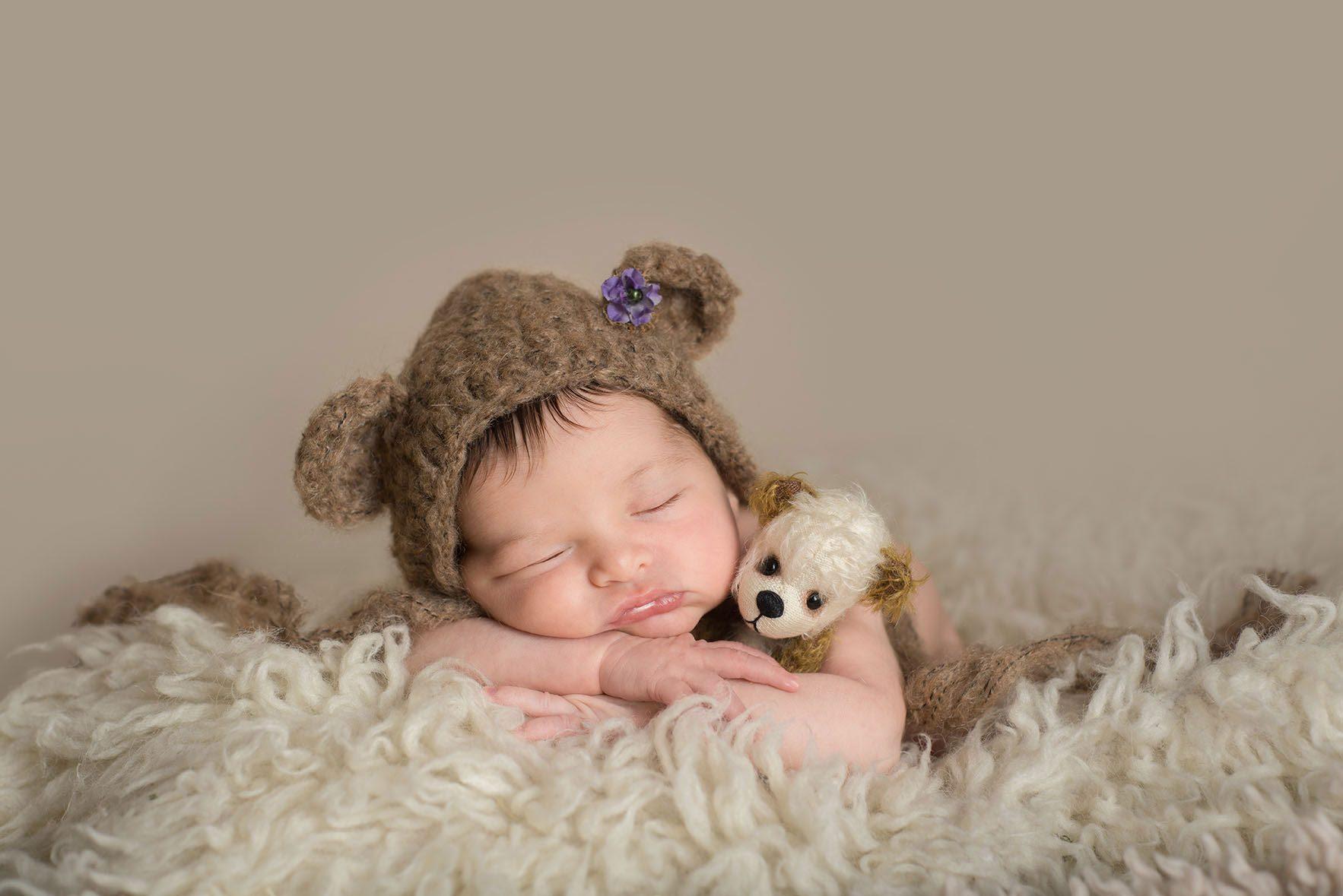 Colchester Essex newborn laying cuddling a teddy bear - Essex newborn photographer
