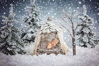 Baby laying in a hessian tent in the snow. Essex baby & newborn photographer