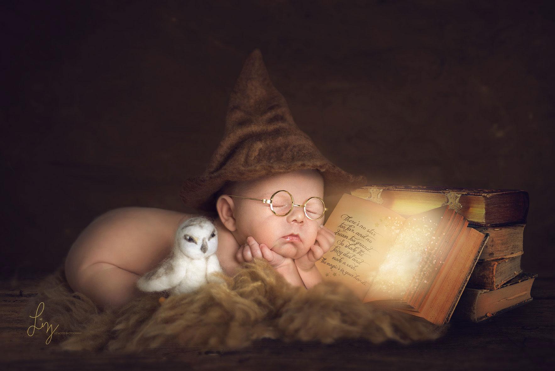 Baby dressed as Harry Potter asleep reading a magic book. Essex creative newborn photographer
