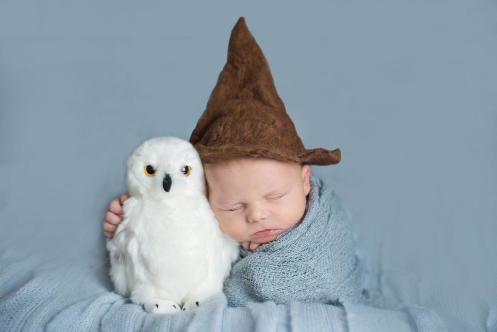 Harry Potter baby potato sack pose cuddling Hedwig