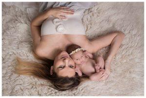Liz Wood: Essex Newborn Photographer - Mum cuddling a baby laying on a cream Flokati rug - Essex & Suffolk newborn photographer