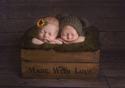 8-week-old-boy-and-girl-twins-laying-cuddling-in-a-wooden-box-for-their-newborn-shoot---Halstead-Essex-baby-photographer