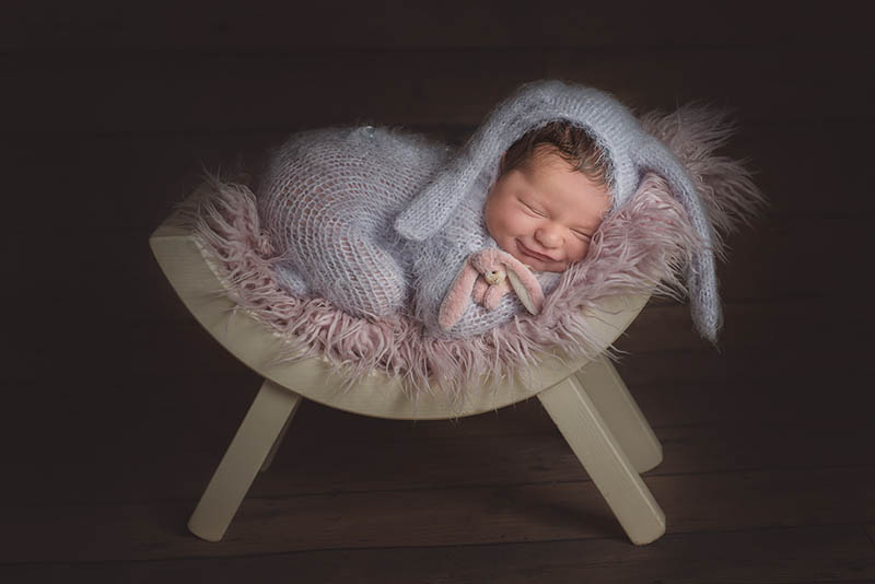 Cute sleeping baby wearing a knitted rabbit outfit - Baby photos in Essex