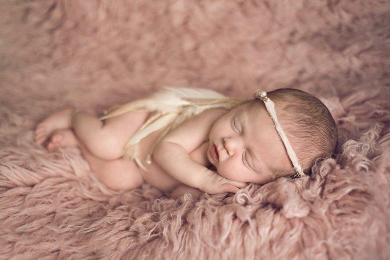 Baby on rug Colchester Newborn Photographer