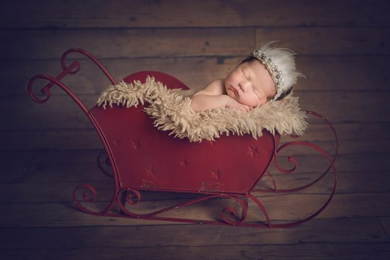 Christmas newborn baby photo - feather halo by Wild Thistle Props - Essex Newborn Photographer.