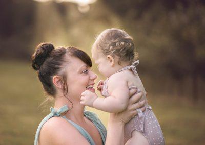 Essex breastfeeding photographer - Mum cuddling toddler