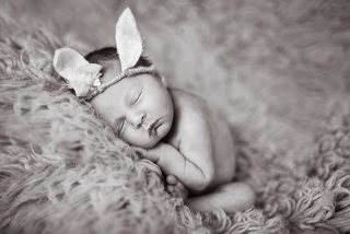 Essex baby photos baby wearing rabbit ears