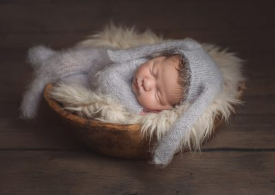 Newborn Photographer Essex - baby wearing a rabbit knitted outfit