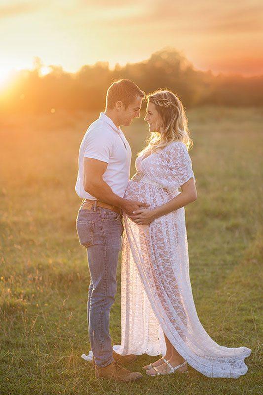 Outdoor maternity photographer Essex - Mum & Dad cuddling at sunset - beautiful bump photos.