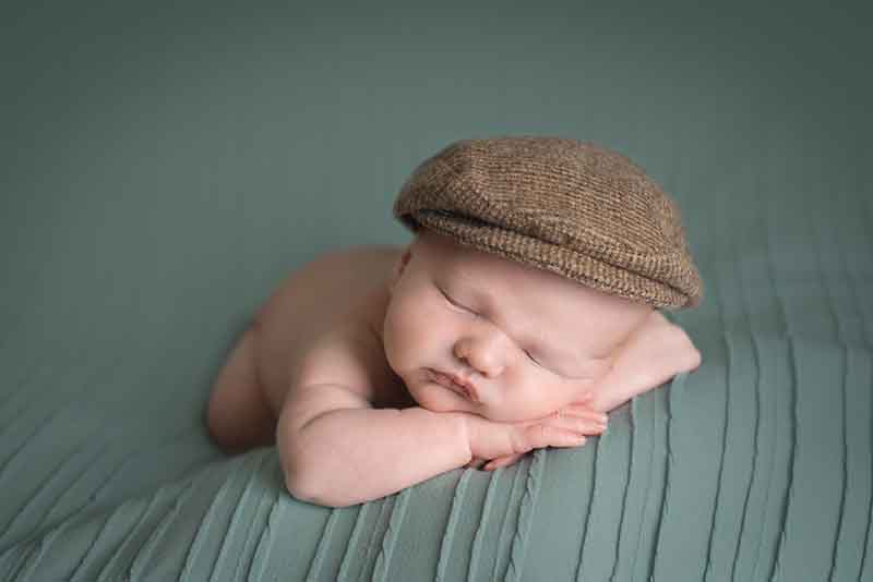 Newborn Photographer Essex - baby in a flat cap