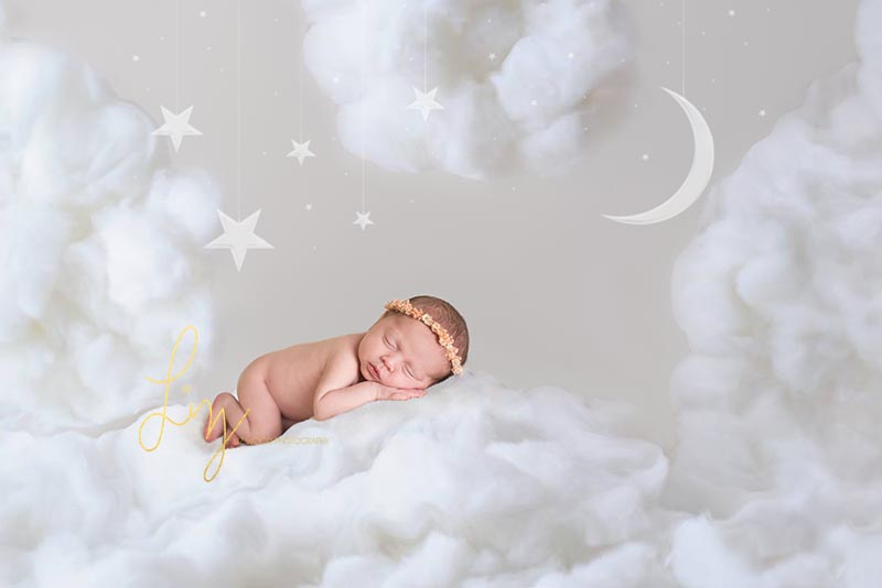 Newborn photographer Essex baby sleeping on cloud
