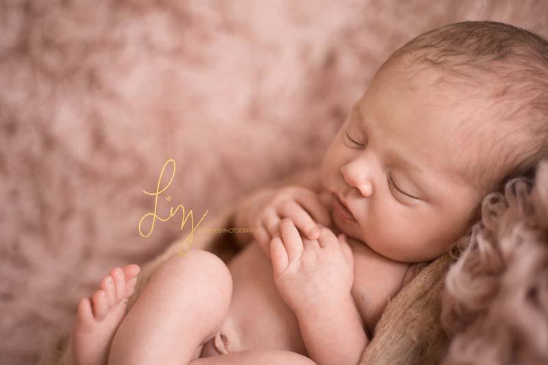 Essex newborn baby girl - laying on pink flokati asleep - baby photos Essex