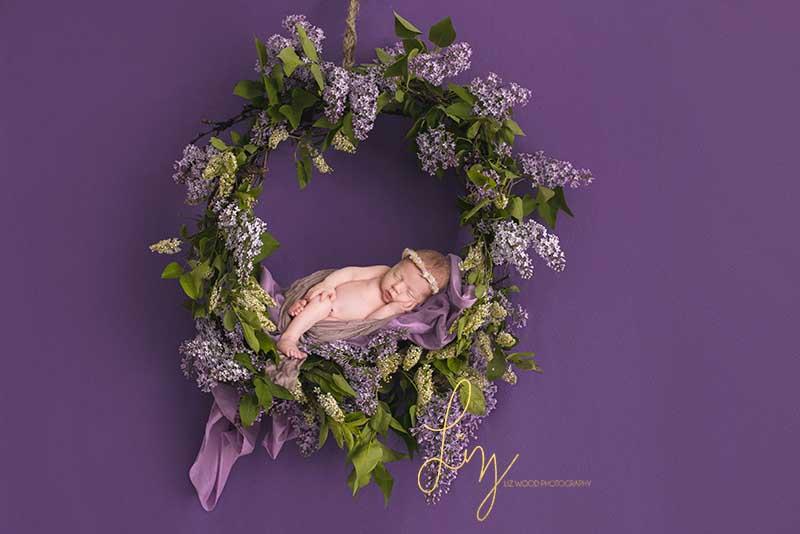 Baby photography in Essex - purple flowers hoop baby prop newborn shoot