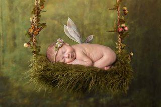 Fairy newborn laying on a flower swing - bespoke Chelmsford Essex Newborn Photographer