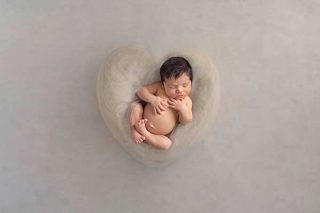 Baby boy in a cream heart - Essex newborn baby photography