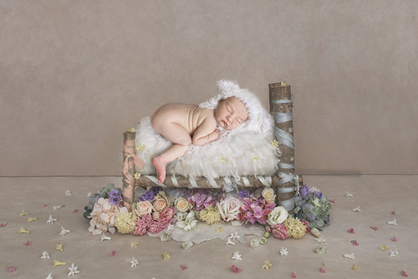 A sweet rainbow baby on her newborn photoshoot