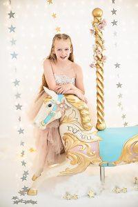 Bury St Edmunds child photographer Studio shoot with a carousel horse