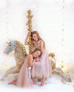 Girls photoshoot on a carousel horse near to Ipswich Suffolk
