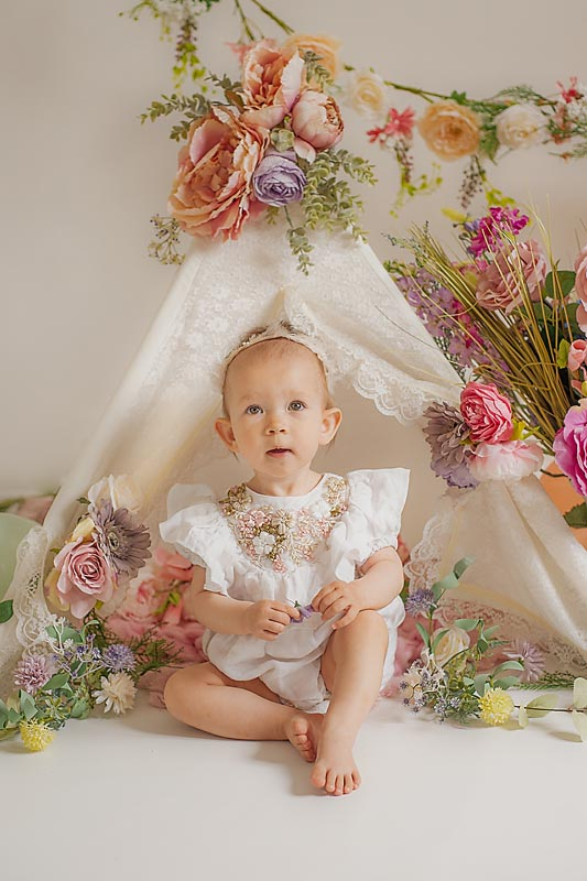 Beautiful boho flower cake smash - Child photographer Suffolk